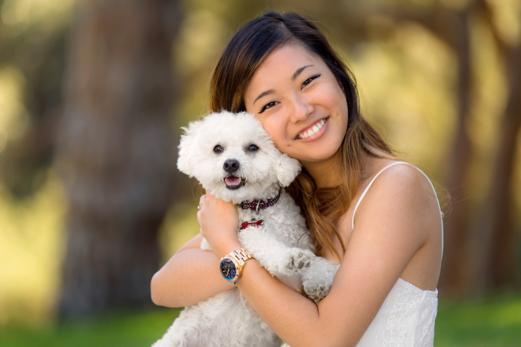 Women Holding White Dog